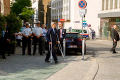 U.S. Secretary of State John Kerry, recovering from a broken leg, approaches a podium to address an international press corps on July 5, 2015, in Vienna, Austria, during a break in P5+1 negotiations with Iranian leaders about the future of their country's nuclear program. [State Department photo/ Public Domain]