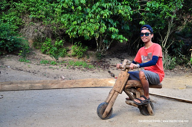 Riding a wooden bike in Butbut Proper
