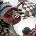 Tony Kanaan kisses the Borg Warner