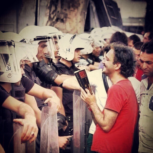A man #reading to #riot #police in #Istanbul, #Turkey. #peace #protest #truth #value #honour #earth #occupy