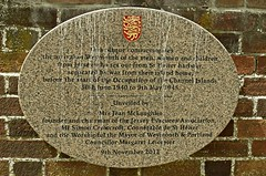 Photo of men, women and children from Jersey stone plaque