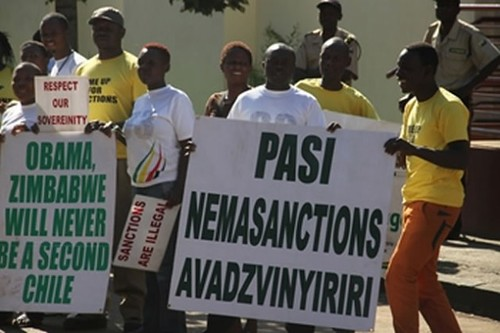 Children of Zimbabwe war veterans demonstrating against illegal sanctions outside the United States embassy in Harare. by Pan-African News Wire File Photos