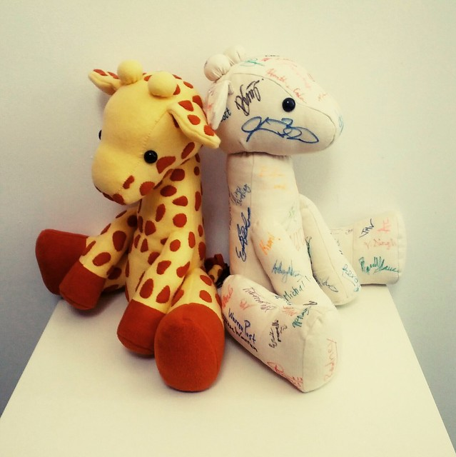 Giraffe plush from the Last of Us & Giraffe plush signed by Naughty Dog crew