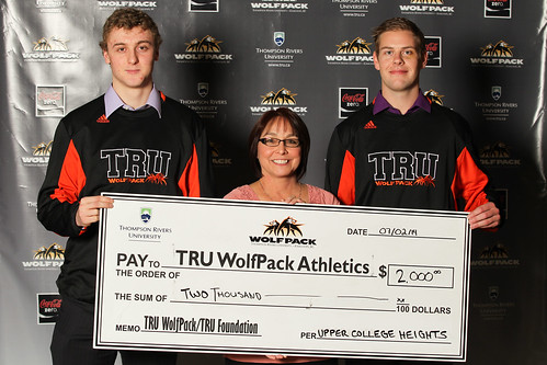 Scott Bollifer (left) and Travis Herlein (right) of hockey with Upper College heights cheque presented by Judy (Feb 2014)