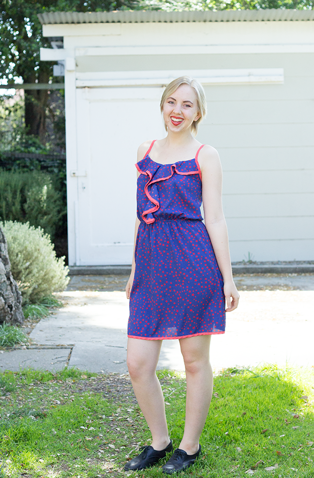 blue sundress with red trim and star pattern