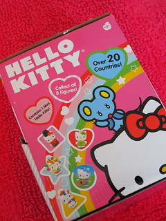 Box of Hello Kitty World Adventure collectible trading cards, stickers and mini figures