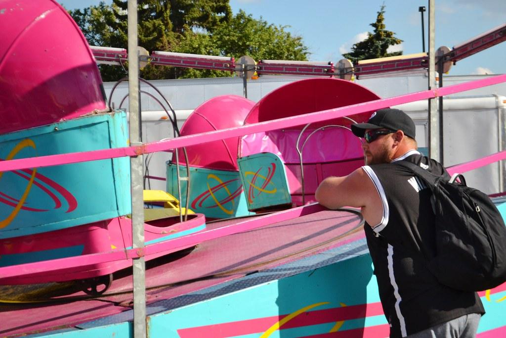 Man Watching Tilt-A-Whirl Ride | Vegan Butterfly | Flickr
