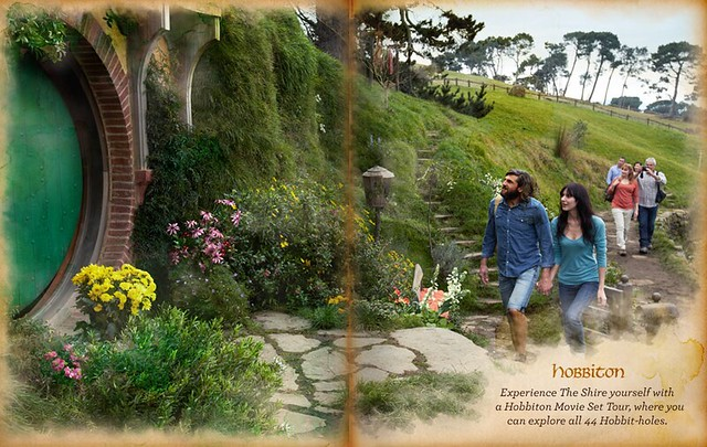 A white couple heads into a hobbit hole in a tourism brochure