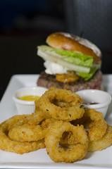 fish(0.0), vegetarian food(0.0), seafood(0.0), produce(0.0), meal(1.0), junk food(1.0), vegetable(1.0), hamburger(1.0), fried food(1.0), side dish(1.0), onion ring(1.0), food(1.0), dish(1.0), cuisine(1.0), fast food(1.0),