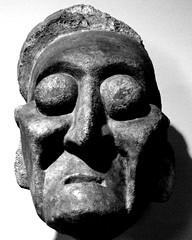 clothing(0.0), costume(0.0), mask(0.0), bone(0.0), skull(0.0), headgear(0.0), masque(1.0), art(1.0), face(1.0), sculpture(1.0), head(1.0), monochrome photography(1.0), monochrome(1.0), illustration(1.0), black-and-white(1.0),