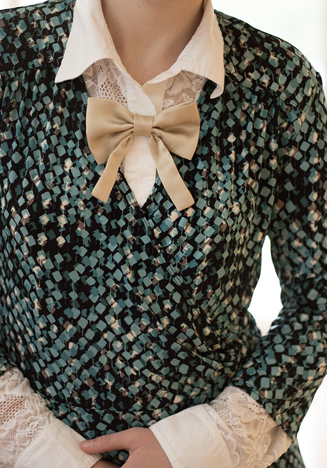 green patterned dress over white lace button-down, gold silk bow