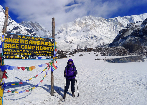 posing by the Annapurna Base Camp marker