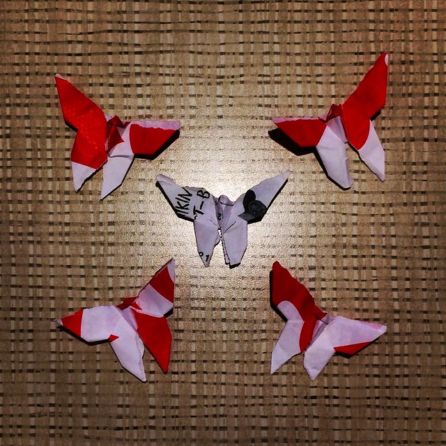 Butterfly origami of red patterns fly around @chikfila #fastfoodorigami