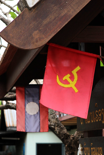 A communist flag and a Lao flag in Luang Prabang
