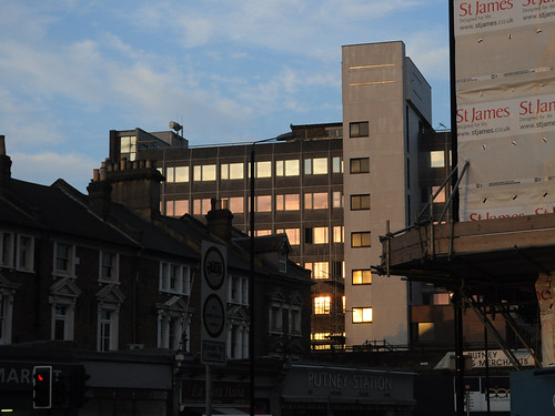 Putney Plaza's fiery glazing near sunset