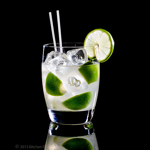 Caipirinha Cocktail in rocks glass with lime garnish