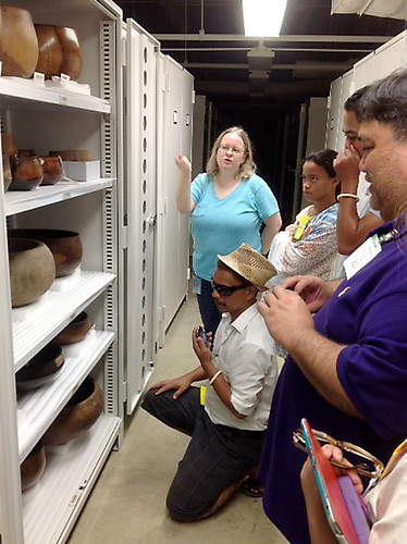 <p>The University of Hawaii delegation was treated to a special visit to the archives of the Smithsonian's Natural History and Anthropology Collections. A Smithsonian guide describes the derivation of carved wooden bowls from Hawaii, early to mid 1800s.</p>