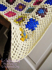 A few of one of the blanket corners, made with the granny square stitch pattern in off-white yarn.