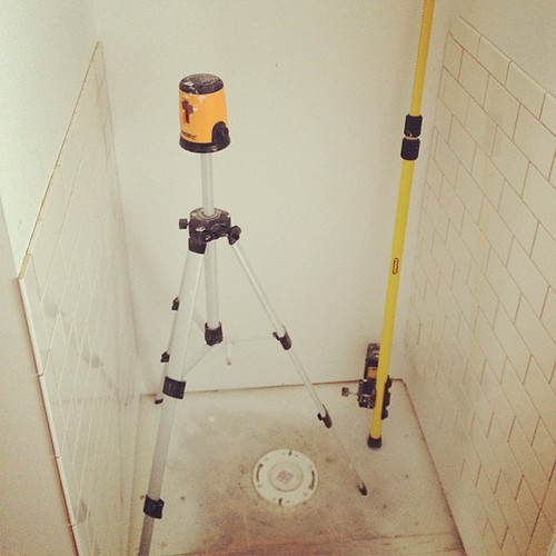 Tile wraps and surrounds toilet nook.