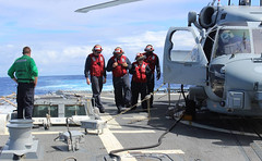Sailors inspect USS Kidd's (DDG 100) flight deck while operating in the Indian Ocean March 16. (U.S. Navy)
