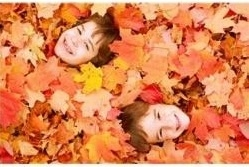 6 year old boys laying in leaves