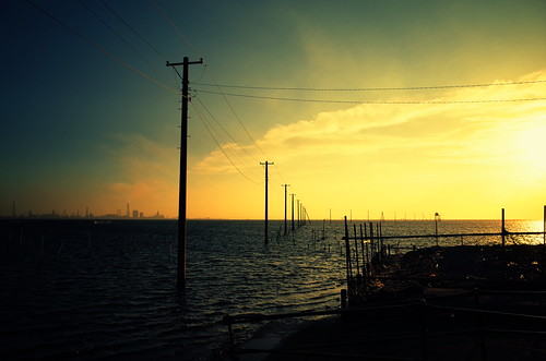 offshore poles at sunset