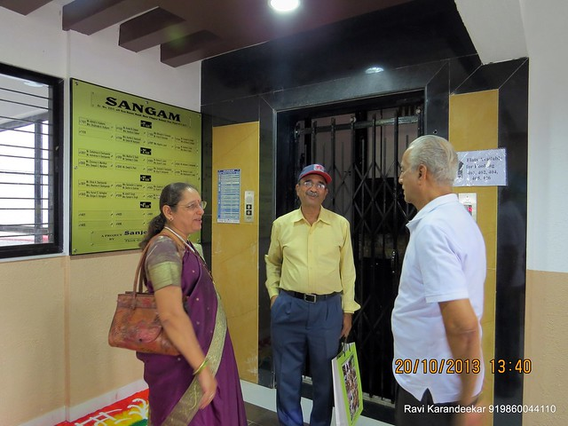 Pro. Deshpande, father of the builder in conversation with the home owners - Handing Over Ceremony of Sanjeevani Developers' Sangam at Sus on Sunday 20th October 2013