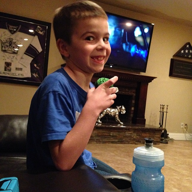 My kid looks like he is up to no good eating a cupcake tonight. Apparently he had 5 of the Superbowl cupcakes that I made. He never eats sweets like this. #superbowl14 #cupcakes