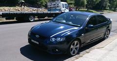 automobile(1.0), automotive exterior(1.0), wheel(1.0), vehicle(1.0), ford fg falcon(1.0), full-size car(1.0), mid-size car(1.0), ford motor company(1.0), compact car(1.0), bumper(1.0), ford(1.0), sedan(1.0), ford falcon (australian version)(1.0), land vehicle(1.0),