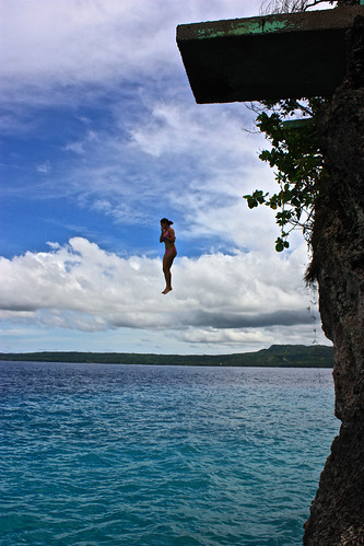 Lina cliff diving in Siquijor, Philippines