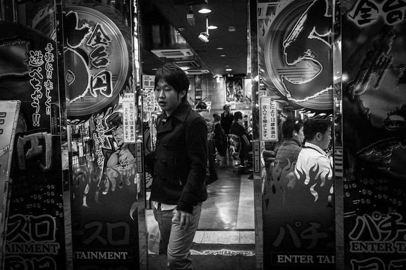 A youth leaving one of the numerous arcades found in Shinjuku.