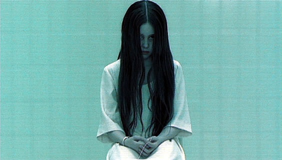 The creepy girl from the Ring, with long black hair over her face