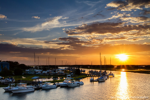 sunset sun beautiful clouds sailboat docks sunrise river landscape outdoors harbor dock peace unitedstates florida speedboat relaxing calming peaceful coastal serenity catamaran coastline serene marsh sailboats relaxation fishingboat cloudscape fernandinabeach intercoastalwaterway northflorida ameliaisland marnina sunshinestate nassaucounty northeastflorida floridasfirstcoast eganscreek dawnamoorephotography tigerpointmarina