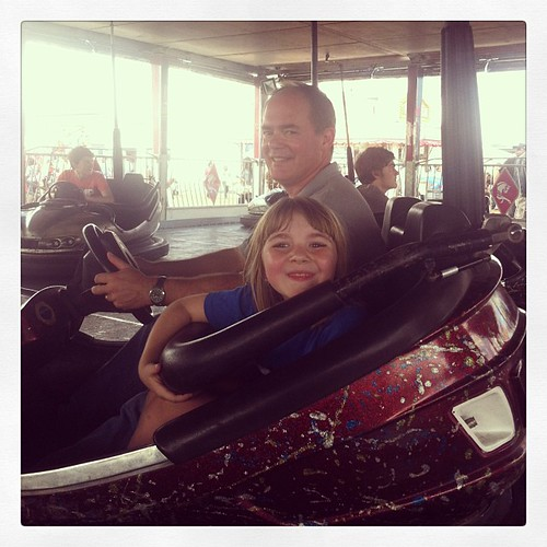 Daddy and daughter on a mission. #msstatefair2013 #bumpercars #statefair #daddyanddaughter