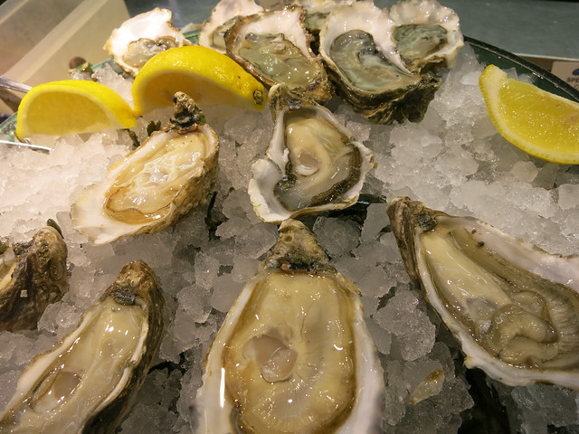 Eating oysters at Chez Leon.