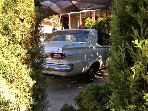 street light white green classic car modern vintage emblem landscape living bush treasure view peekaboo tail style delta neighborhood hidden driveway chrome hedge dodge parked gt dart midcentury riovista aerodynamic