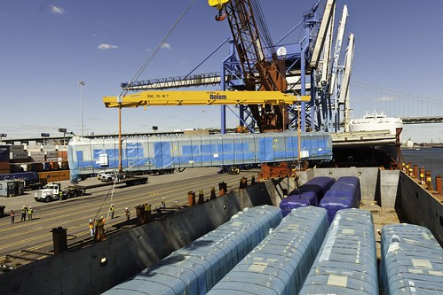 Photo of steel sheel of rail car being unloaded from cargo ship at Port of Philadelphia