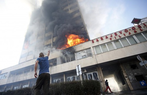 Building set alight by protesters in Tuzla, Bosnia. People are rebelling against unemployment rates of over 44 percent. by Pan-African News Wire File Photos
