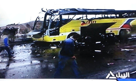 An Egyptian tour bus was damaged in a blast, killing four in Taba on the Red Sea. The incident took place on Feb. 16, 2014. by Pan-African News Wire File Photos