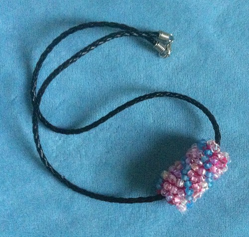 Felt Bead with Blue Swirl on a Black Cord by randubnick