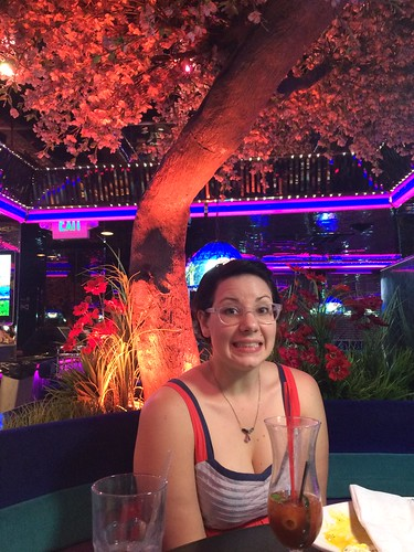 Tracy under the neon tree at our table at The Peppermill