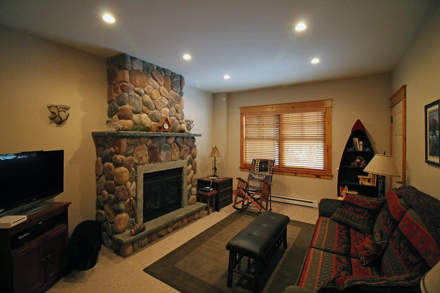 Lower level family room with stone fireplace;
