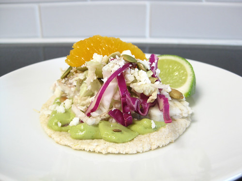Citrus-Glazed Barramundi Fish Tacos with Avocado-Serrano Crema, Toasted Cumin Pepitas and Bicolor Slaw