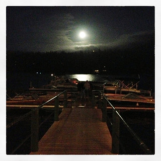 full moon on the lake at the docks