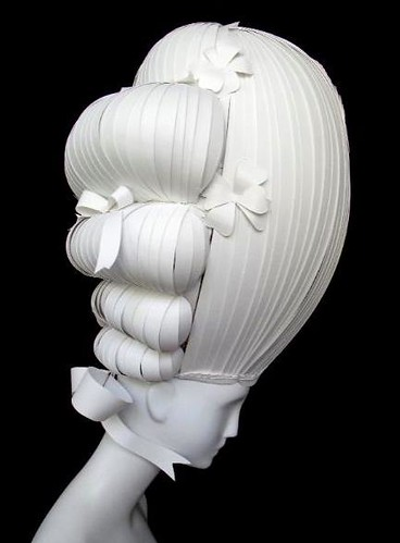 ornate white paper wig on mannequin