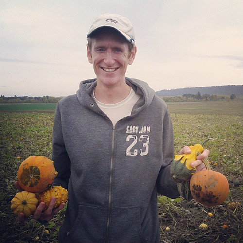 Jordan picks some pumpkins.