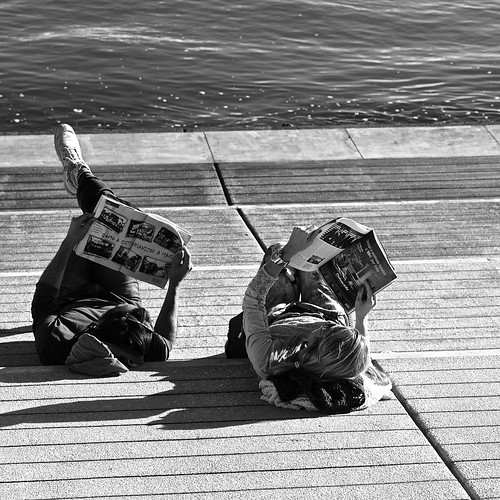Couple reading the news on a sunny afternoon