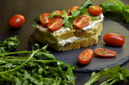 Tomato and arugula sandwich with eggplant creme cheese III
