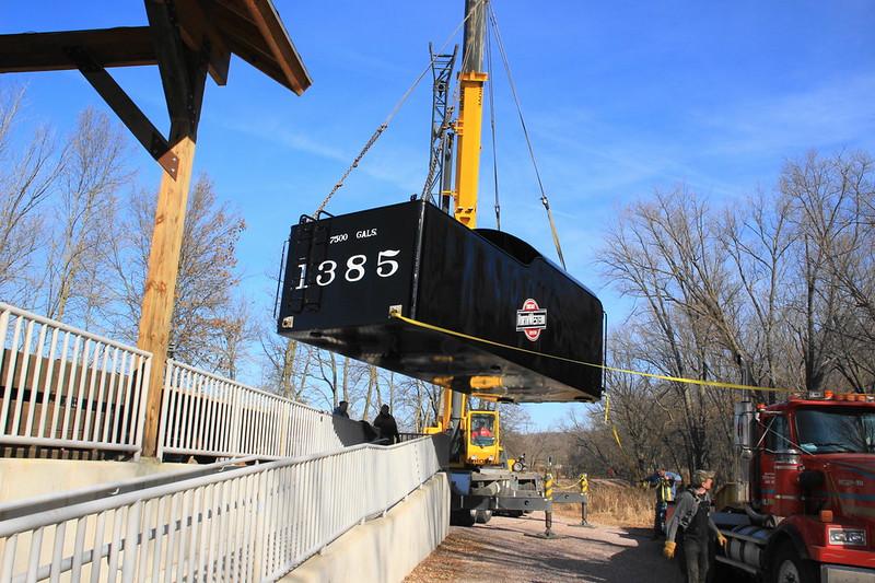 Tender tank hoisted by crane