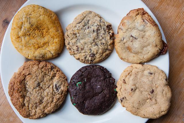 Smores, chocolate chip, milk chocolate caramel, dark chocolate toffee, chocolate mint, and peanut butter chocolate cookies, Milk & Cookies